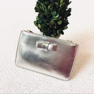 Youmi K silver clutch with bow EUC